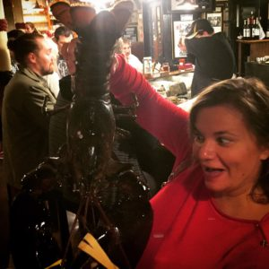 Gina Pacelli Holding a Lobster at the Union Oyster House